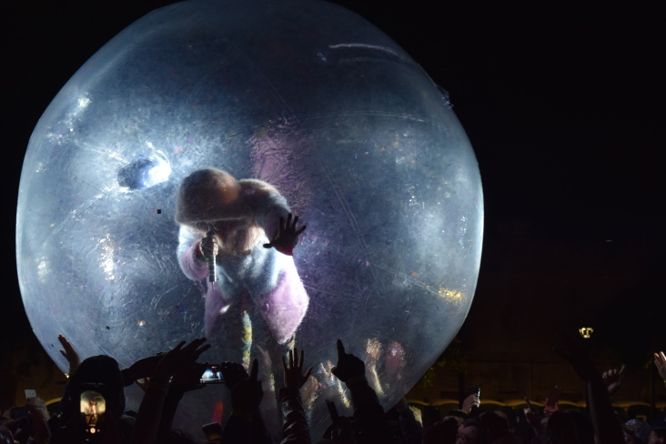 "Wayne Coyne getting out into the crowd during The Flaming Lips cover of David Bowie's song, ""Space Oddity"" during The Major Rager (2017) in Augusta, Ga."
