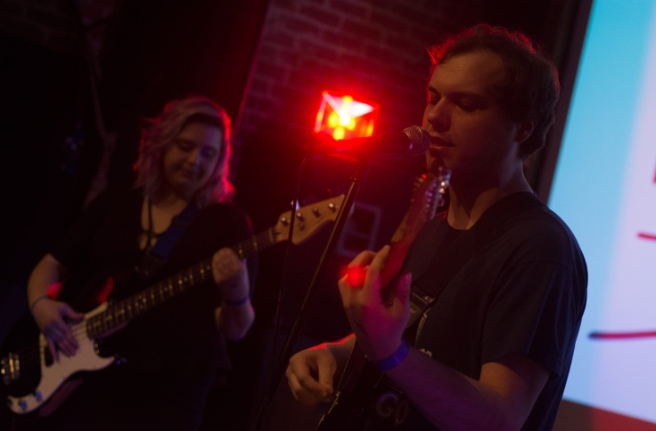 The Handsome Grandsons male guitarist and female bassist on stage at the Palace Theatre